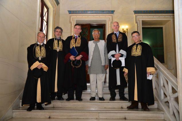 Ο Πρύτανης, καθηγητής Μ.-Α. Δημόπουλος αναφέρθηκε κατά την προσφώνησή του στο συνολικό έργο και την προσφορά του Καθηγητή κ. Muhammad Yunus.